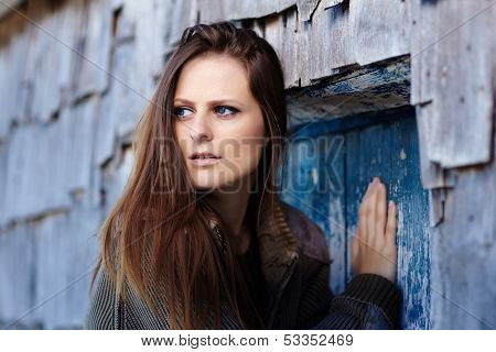 Scared Woman Pushing Into A Door