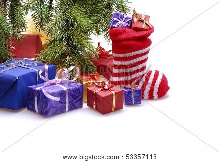 gift boxes  with stocking  under  Christmas tree