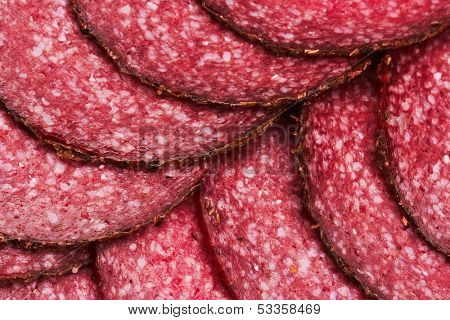Salami background with sliced pieces of salami