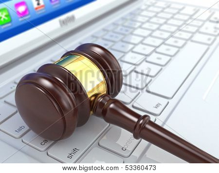 Online judgement. Gavel on laptop. Conceptual image. 3d
