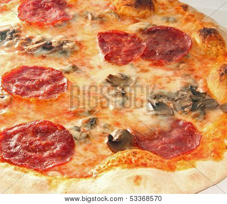 Tasty Pizza With Pepperoni And Mushrooms