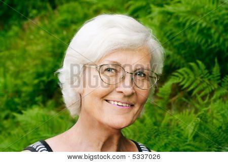 Senior Woman  On Fern Background