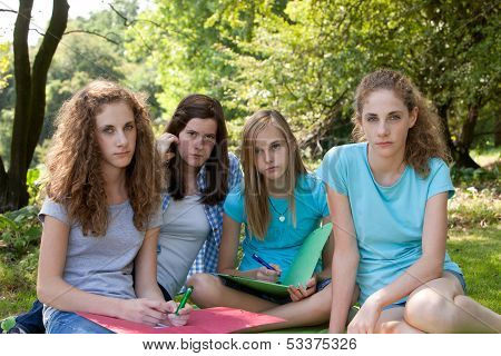 Group Of Sombre Young Teenagers
