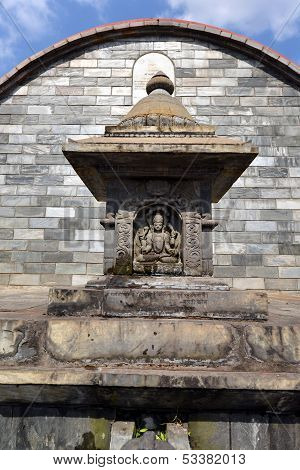 Graved statue of God Shiva on a public stone fountain. Pashupatinath, Nepal