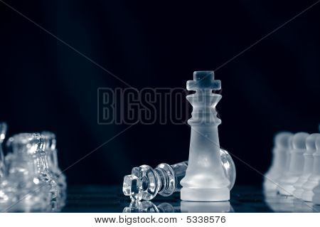 Checkmate With Glass King Lying On Chessboard