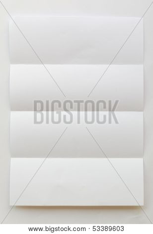 White Textured Sheet Of Paper Folded