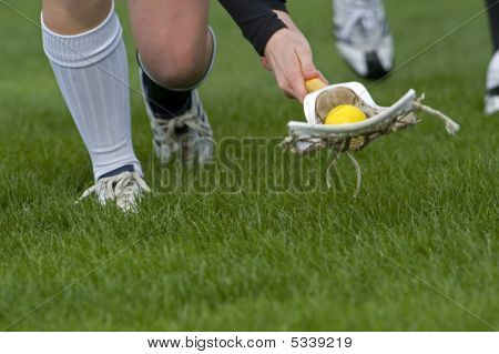 Girls Lacrosse Scooping Up The Ball
