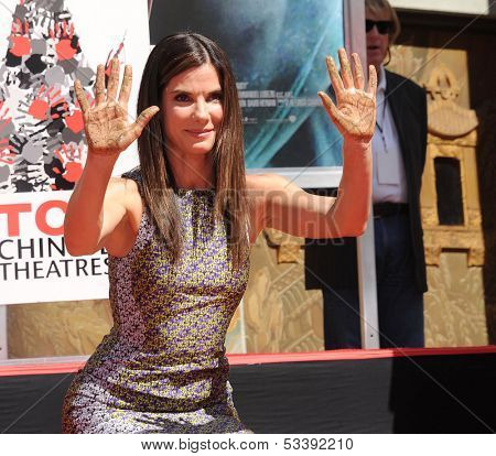 LOS ANGELES - SEP 25:  Sandra Bullock arrives to Sandra Bullock Hand & Foot Print Ceremony  on September 25, 2013 in Hollywood, CA