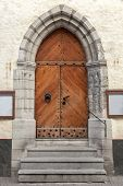 Gothic Wooden Door With Decoration Elements In Old Building Facade. Tallinn, Estonia