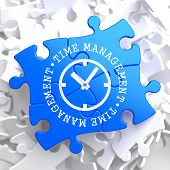 picture of time-piece  - Time Management with Icon of Clock Face Written on Blue Puzzle Pieces - JPG