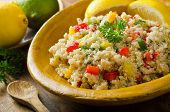 stock photo of quinoa  - A healthy delicious quinoa salad with lemon lime red pepper yellow pepper green onion and parsley - JPG