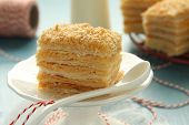 stock photo of cream puff  - Piece of Napoleon cake layer cake from puff pastry with custard cream
