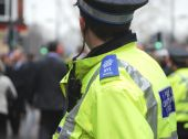 stock photo of bobbies  - Police community support officer in busy high street - JPG