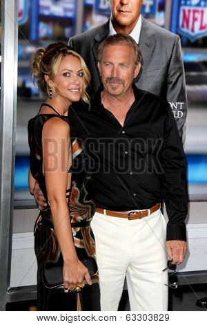 LOS ANGELES - APR 7:  Christine Baumgartner, Kevin Costner at the