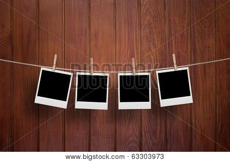instant photo frames on wooden wall