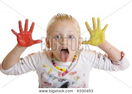 Young Child Full Of Paint Makes Grimace