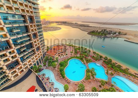 ABU DHABI, UAE - MARCH 27: Pool area of Khalidiya Palace by Rotana at sunrise on March 27, 2014, UAE. Rotana Hotel Management Corporation has 85 properties in 26 cities around Middle East and Africa.