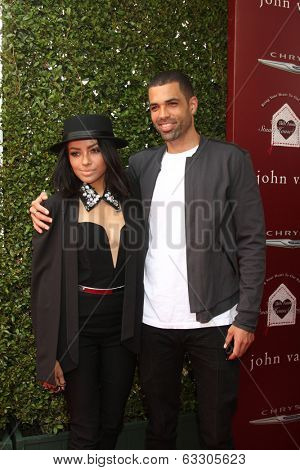 LOS ANGELES - APR 13:  Kat Graham, Cottrell Guidry at the John Varvatos 11th Annual Stuart House Benefit at  John Varvatos Boutique on April 13, 2014 in West Hollywood, CA