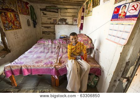 KATHMANDU, NEPAL - DEC 9, 2013: Unknown child after lesson at Jagadguru School. School established at 2013, to let new generation learn Sanskrit and preserve Hindu culture.