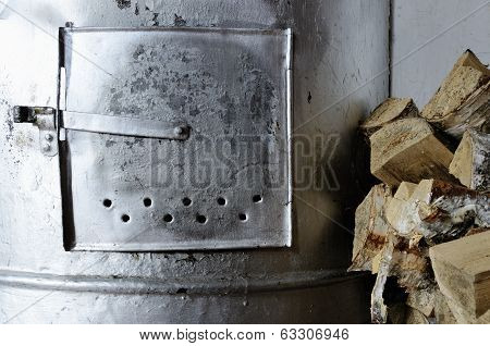 Old Stove And Birch Firewood