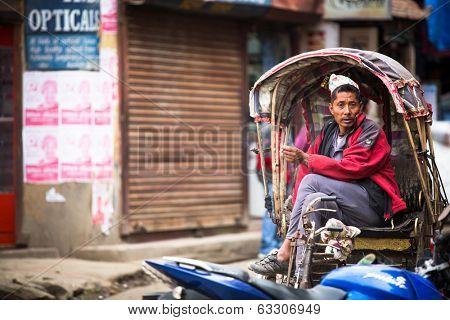KATHMANDU, NEPAL - NOV 28, 2013: Unidentified nepali rickshaw in historic center of city. Largest city of Nepal, its historic center, a population of over 1 million people.