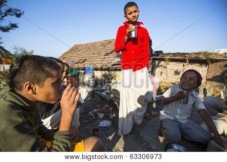 KATHMANDU, NEPAL - DEC 9, 2013: Unknown children during breakfast at Jagadguru School. School established at 2013, to let new generation learn Sanskrit and preserve Hindu culture.