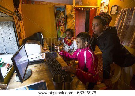 KATHMANDU, NEPAL - DEC 9, 2013: Unknown children in lesson on the computer at Jagadguru School. School established at 2013, to let new generation learn Sanskrit and preserve Hindu culture.