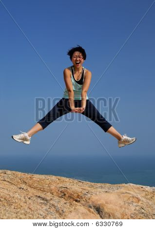 Young women jumping cheerfully outdoor
