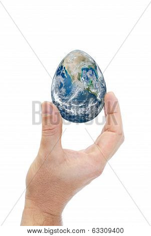 Human Hand Holding Egg Shaped Planet Earth..