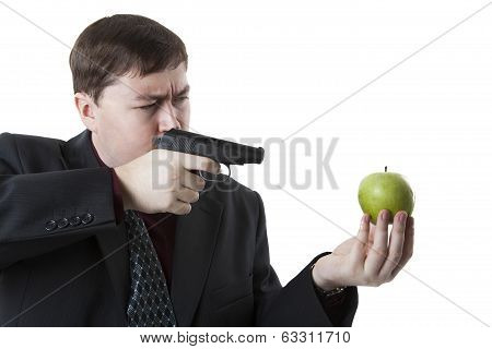 Man Aims At The Apple On His Hand