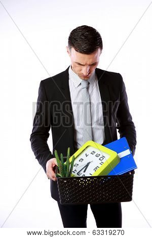 You are fired! Businessman hold box with personal belongings on gray background