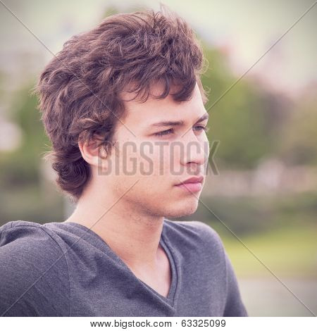 sad teenager looking away in outdoor