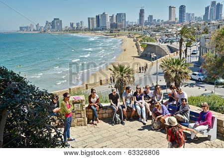 A Group Of Turists Near The Mediterranean