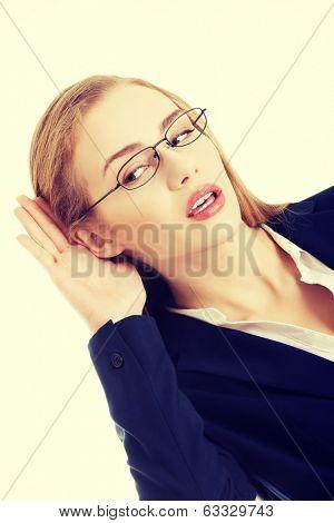 Beautiful caucasian business woman is overhearing.