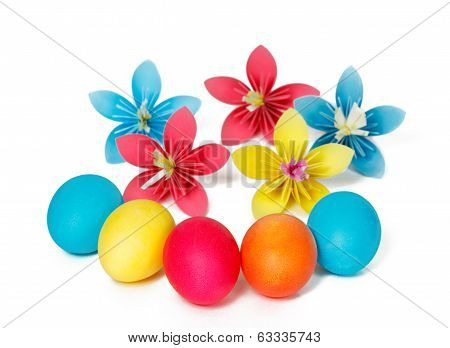 Many Easter eggs and colored paper flowers