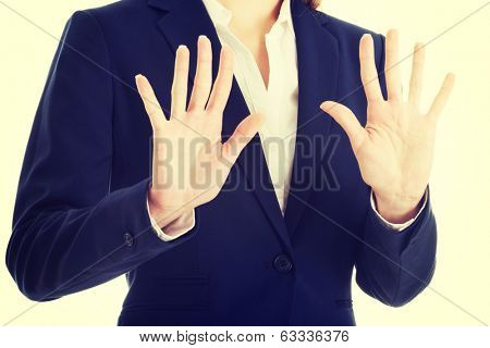 Beautiful caucasian business woman showing stop gesture.