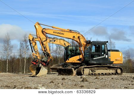 Excavators At Construction Site