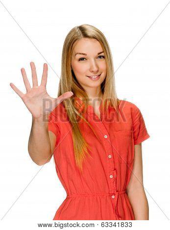 Portrait of smiling woman showing five fingers