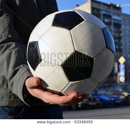 Soccerball In A Hand Of The Teenager. Future Champion.