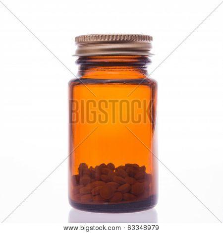 Glass bottle of pills