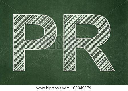 Advertising concept: PR on chalkboard background