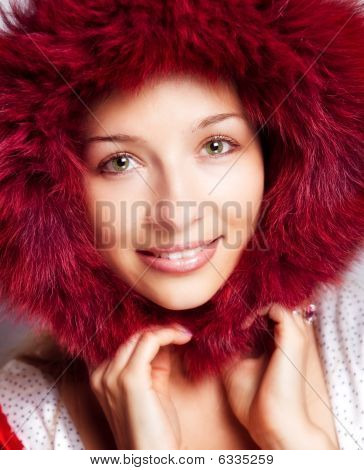 Winter Portrait Of Happy Woman With Fur Hood