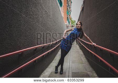 Pretty Girl Posing In A Urban Underpass