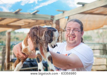 Happy Farmer With A Goatling