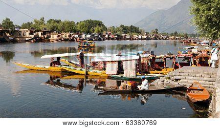 KASHMIR, INDIA - AUG 3 Shikara boats on Dal Lake with houseboats in Srinagar - Shikara is a small bo
