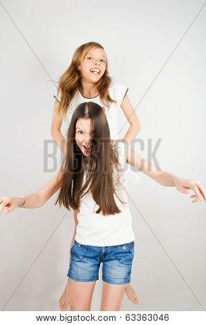 Laughing Teen Girls Jumping