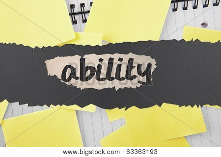 The word ability against sticky notes strewn over notepad