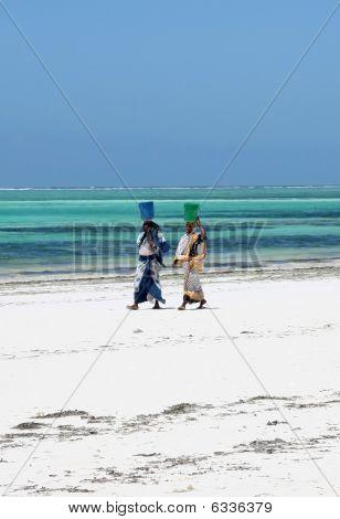 Two Zanzibar Women On Ocean Shore