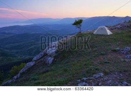 Night landscape with tourist tent on the mouNight landscape with tourist tent on the mountainntain