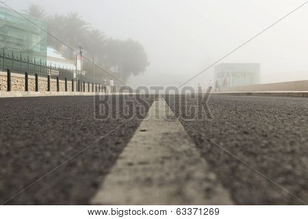 The road leaving afar in fog removed from the earth